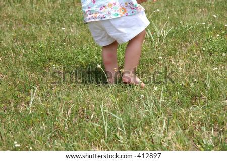 Bug bites on back of baby girl's leg. - stock photo
