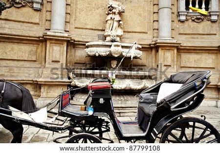 Buggy in the Quattro Canti, one of the octagonal four sides of Baroque square in Palermo - Italy - stock photo