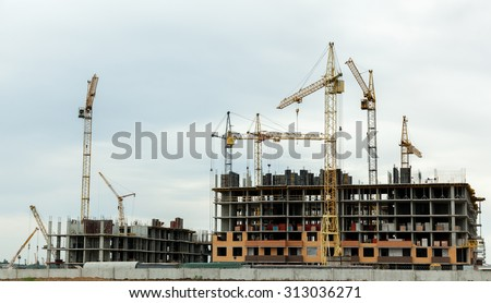 build a house, building site,construction of houses, construction cranes, construction material, city, day, roofing - stock photo