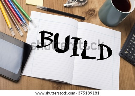BUILD - Note Pad With Text On Wooden Table - with office  tools