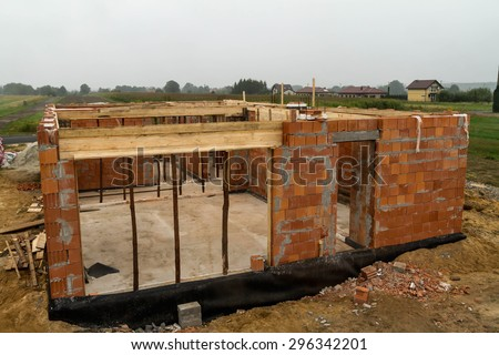 Build of house, wall growing - stock photo