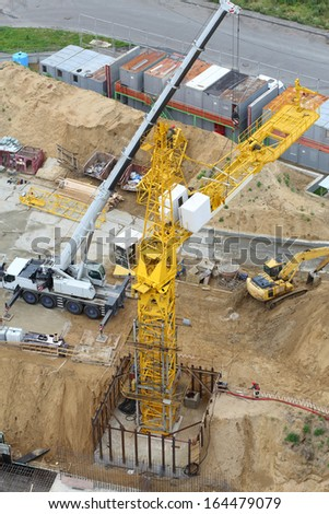 Build of tower crane, excavator and other equipment at construction site. - stock photo