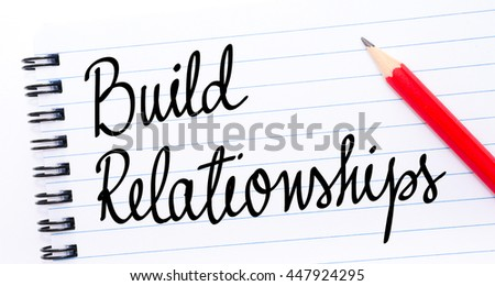 Build Relationships written on notebook page with red pencil on the right