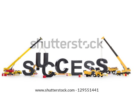 Build up success concept: Black alphabetic letters forming the word success being set up by group of construction machines, isolated on white background.