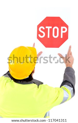 Builder affixing stop sign