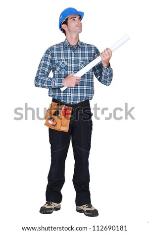 Builder holding plans - stock photo