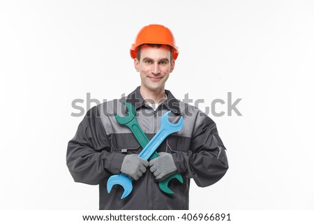 builder holding wrench isolated on white background smile - stock photo