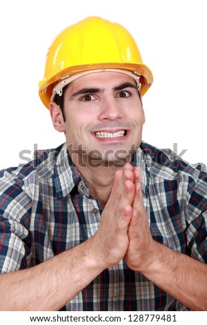 Builder hoping everything goes as planned - stock photo