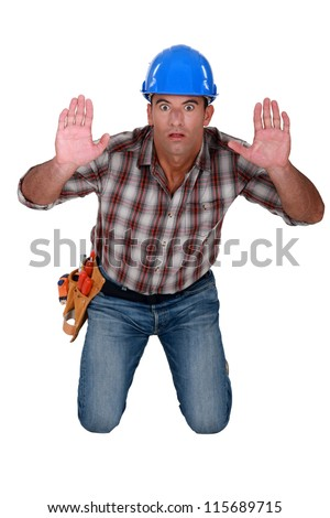 Builder in a state of shock - stock photo