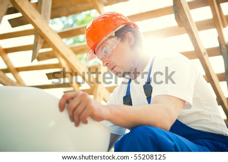 builder looking at the construction project