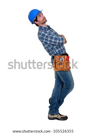 Builder looking up - stock photo