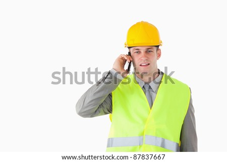Builder making a phone call against a white background