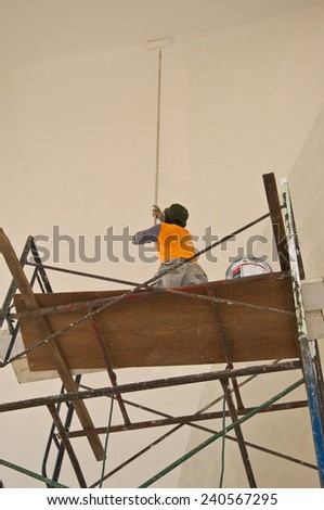 builder  of construction worker on scaffold - stock photo