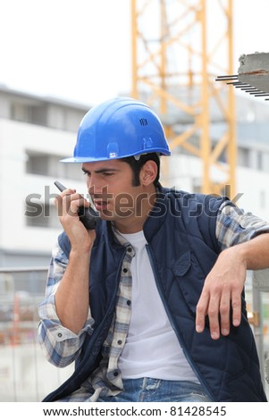 Builder on walkie talkie - stock photo
