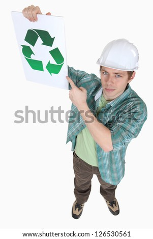 Builder pointing at recycle poster - stock photo