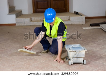 builder polishing the floor after fixing it