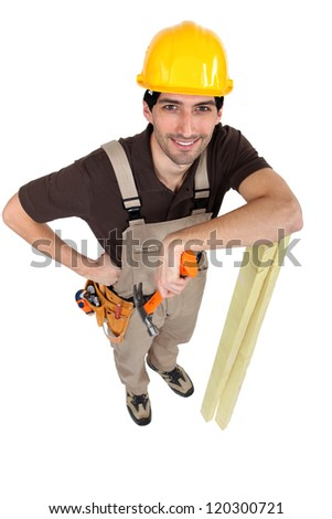 Builder posing with his tools and building supplies - stock photo