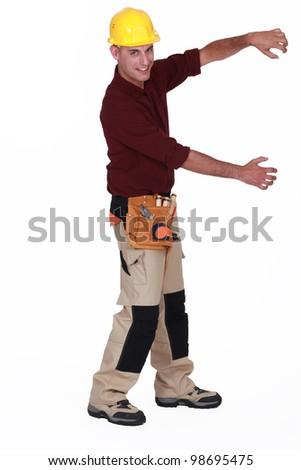 Builder pulling - stock photo