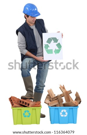 Builder stood by materials to be recycled - stock photo