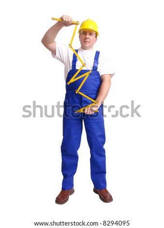 Builder wearing blue jumpsuit and yellow helmet unfolding wooden ruler over white background
