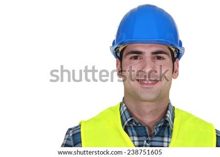 Builder wearing fluorescent jacket - stock photo