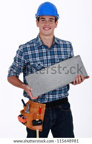 Builder with a concrete block - stock photo