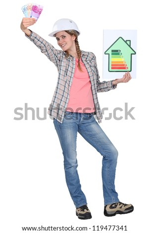 Builder with a energy rating sign - stock photo