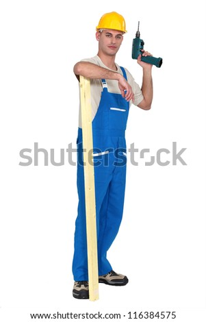 Builder with a power drill - stock photo