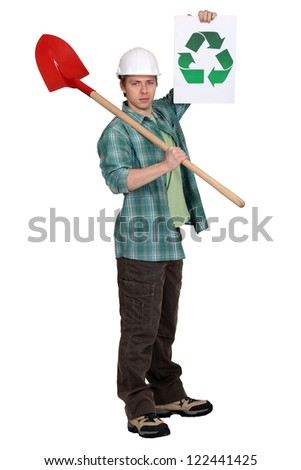 Builder with a recycle sign - stock photo