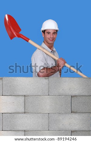 Builder with a shovel - stock photo