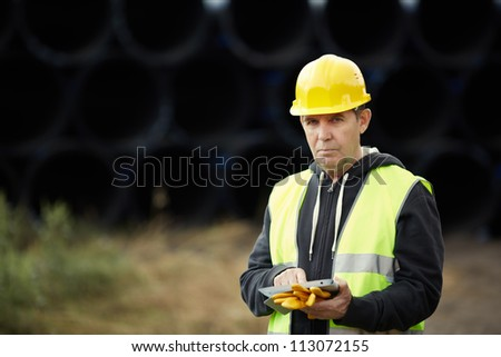 builder with digital tablet - stock photo