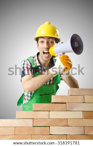 Builder with hard hat on white - stock photo