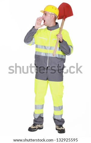Builder with spade shouting to colleague - stock photo