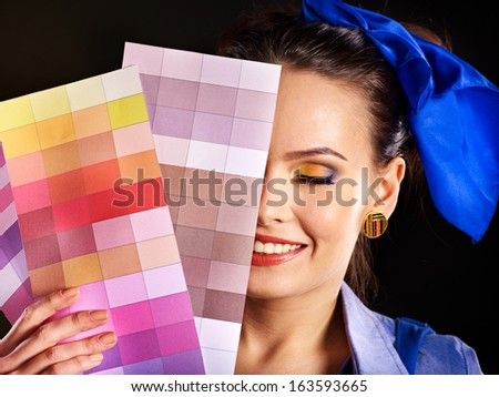 Builder woman with wallpaper and scale color. - stock photo