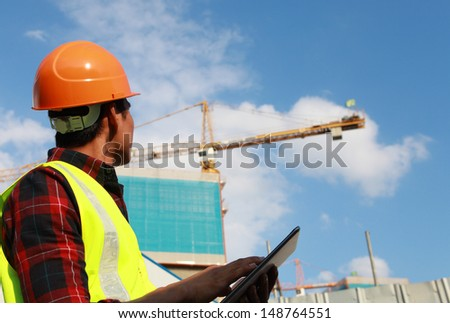 Builder worker activity with digital tablet on construction site - stock photo