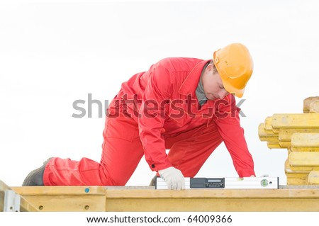 builder worker checking horizontal with digital level tool at construction site - stock photo
