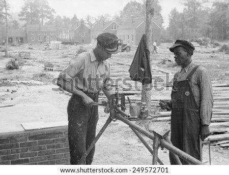 Builders at Newport News Homesteads, Virginia, Sept. 1936. Subsidized by the New Deal Resettlement Administration. - stock photo