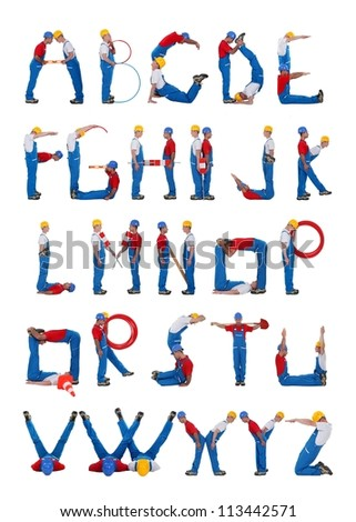 Builders forming the alphabet - stock photo