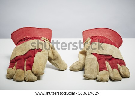 Builders protective gloves isolated on white background. DIY protection and safety concept - stock photo