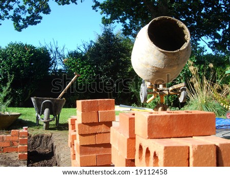 Builders tools in garden. New conservatory being built. - stock photo