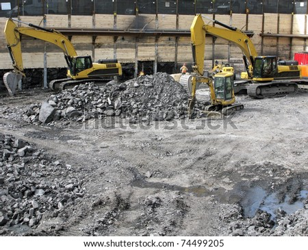 building a foundation with backhoes - stock photo