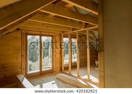building a house with wooden beams, interior construction of partition walls and floors - stock photo