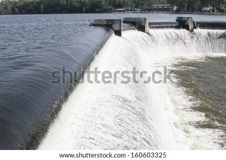 Building a man-made dam. To store water for the dry season, there are many large and small scale by local conditions and terrain. - stock photo