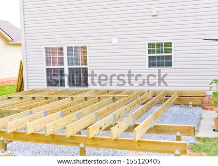 Building a new above ground deck, patio construction. - stock photo