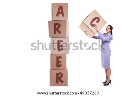 Building a new career concept image, a businesswoman stacking boxes with the letters that spell out CAREER, isolated on a white background. - stock photo