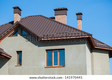 building a new home and roof - stock photo