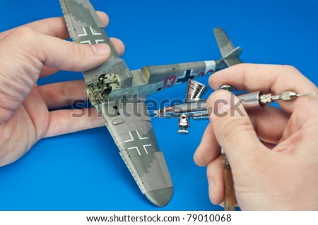 building a plastic model kit of ww2 aircraft - airbrushing - stock photo