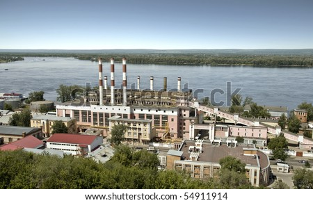 Building a power station in the city of Samara. On the bank of the Volga River. The building was built in 1930, the station was founded in 1904. Cityscape. - stock photo