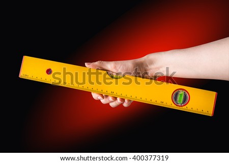 Building a professional-level line in hand. Isolated with clipping path included on a black background. - stock photo