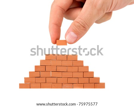Building a small brick wall on white background - stock photo